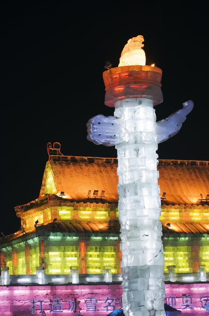 Stock Photo: 4272-4905 China, Northeast China, Heilongjiang Province, Harbin City. Ice Lantern Festival. A colourful ice sculpture replica of the Forbidden City's Huabiao statue and Gate of Heavenly Peace in Beijing illuminated at night.