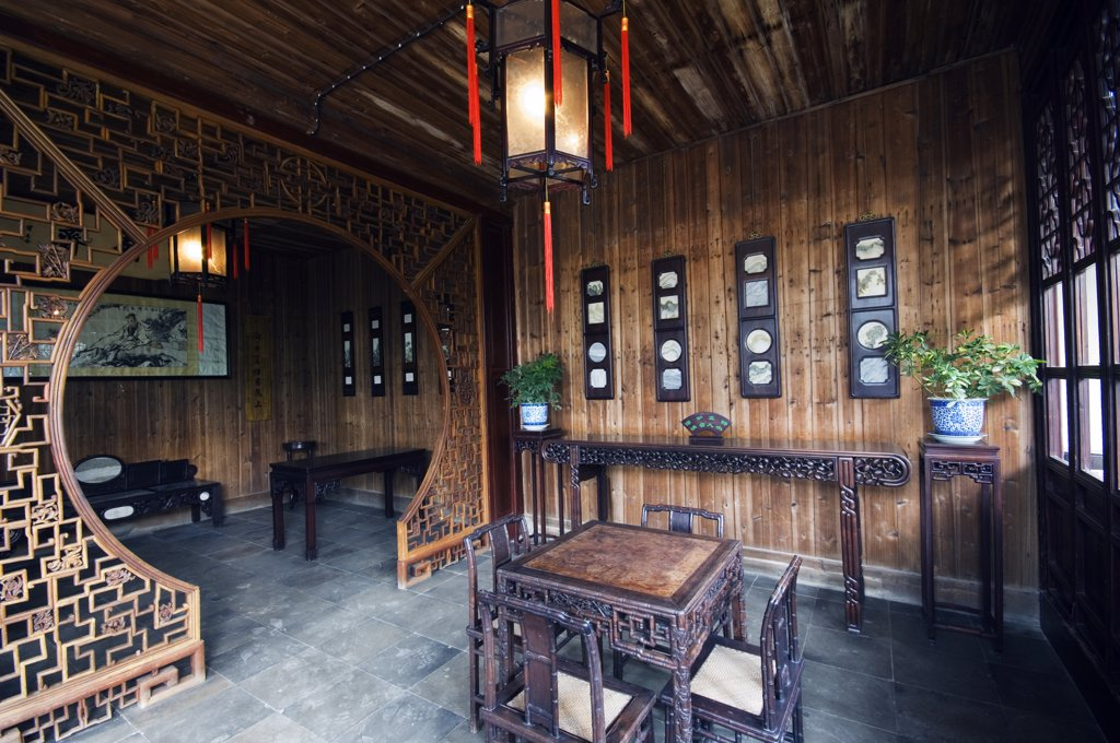 Stock Photo: 4272-4915 China, Jiangsu Province, Suzhou City. The Couples Garden Retreat, decorated in Qing dynasty furniture, built during the reign of Emperor Guangxu (1875-1908) World Heritage listed by UNESCO in 2000.