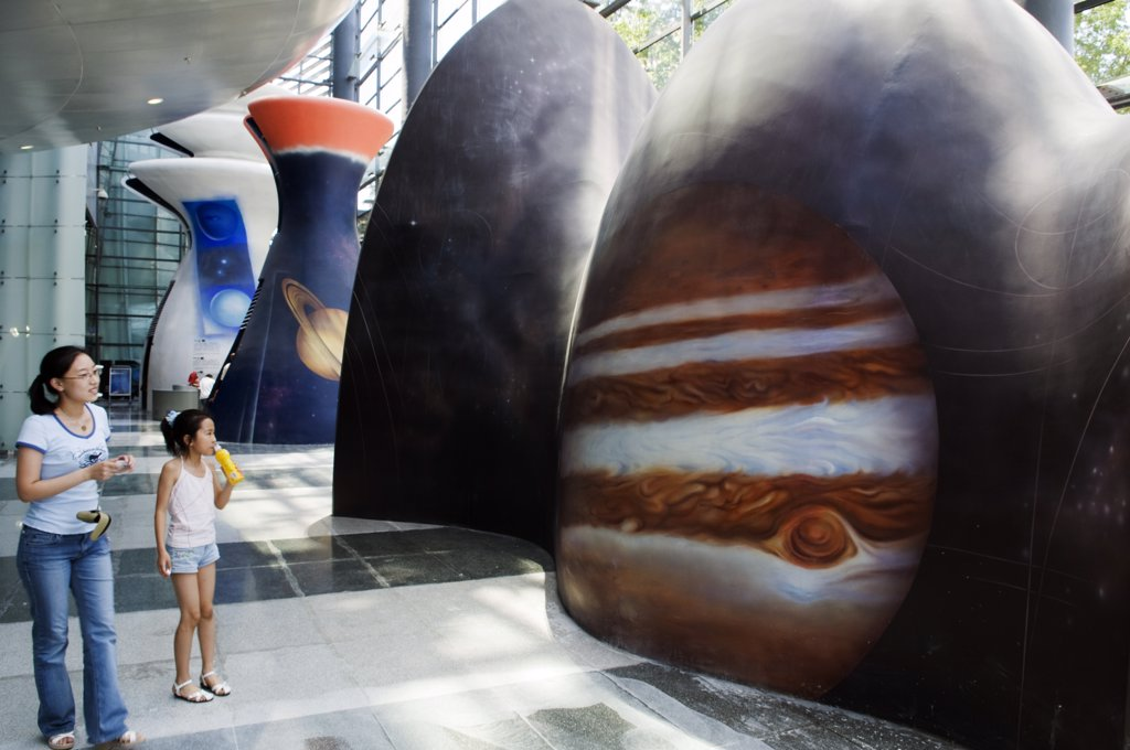 Stock Photo: 4272-5128 China, Beijing. Visitors looking at a display at the Planetarium Museum