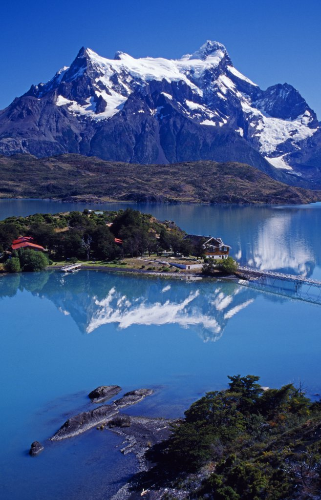 Stock Photo: 4272-6133 Chile, Torres Del Paine National Park, Lago Pehoe. Hosteria Pehoe with Paine Massif behind.
