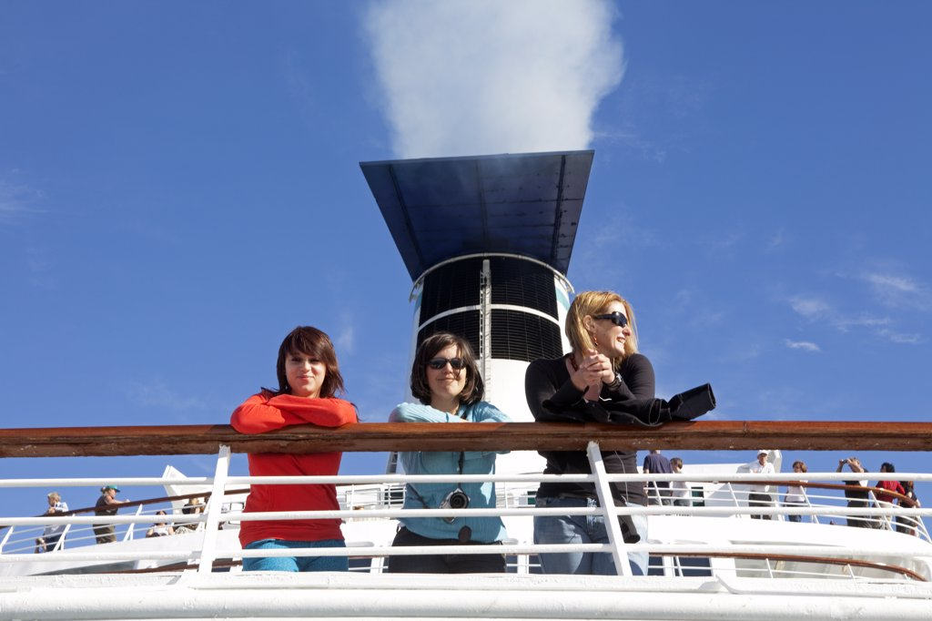 Chile. Three passengers on the MV Discovery Cruise liner. : Stock Photo