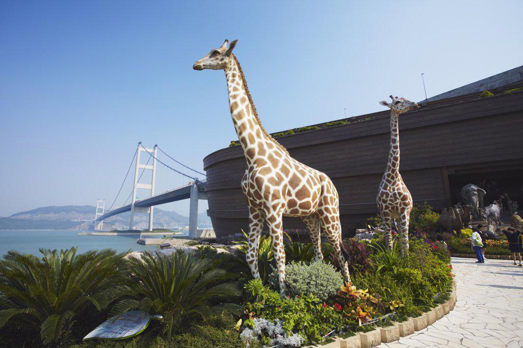Noah's Ark (full size replica) with Tsing Ma bridge in background, Ma Wan, Hong Kong, China : Stock Photo