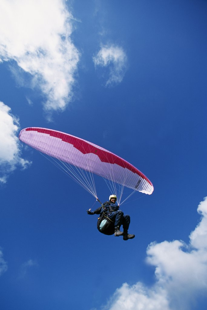 Stock Photo: 4272-7927 A paraglider soars on the South Downs in Sussex. The South Downs have become very popular for paragliding excellent conditions with the summer breezes.