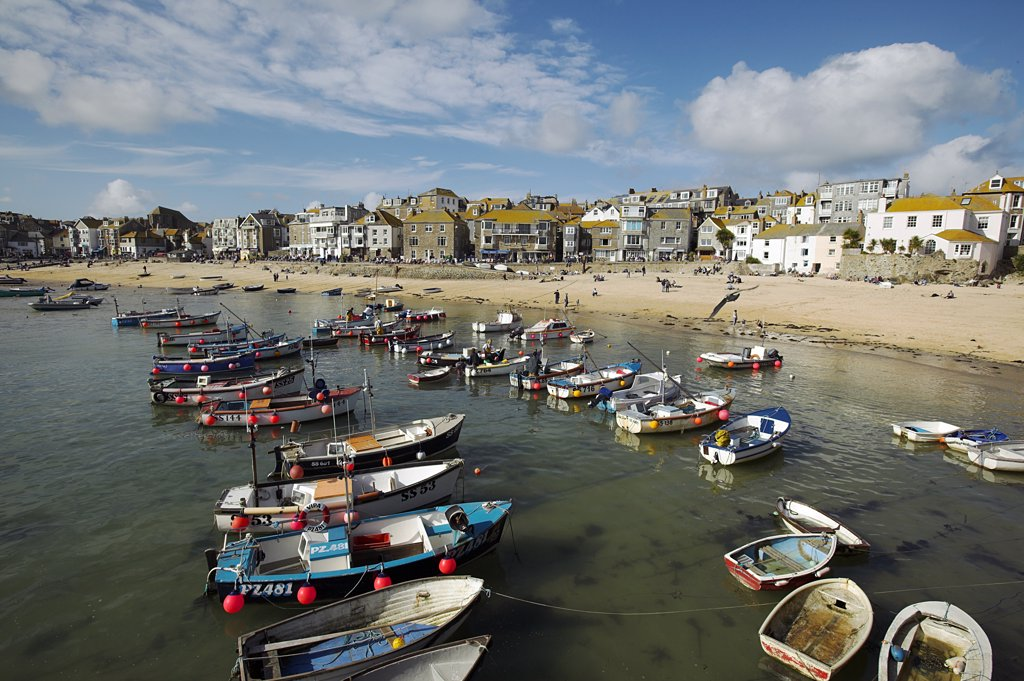 Boats in the harbour of St Ives, Cornwall. Once the home of one of the largest fishing fleets in Britain, the industry has since gone into decline. Tourism is now the primary industry of this popular seaside resort town. : Stock Photo