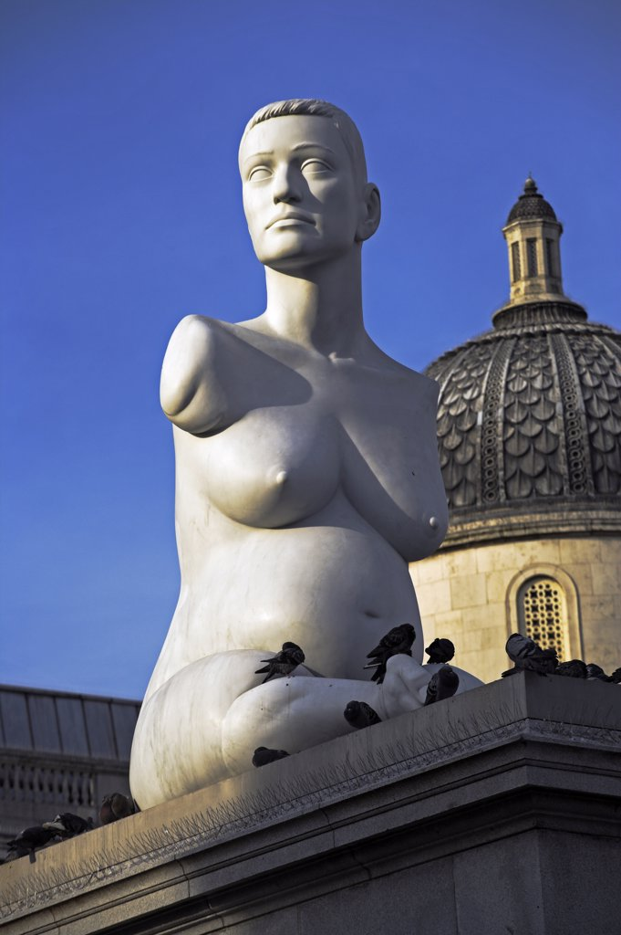 Stock Photo: 4272-8074 The controversial sculpture Alison Lapper Pregnant by Mark Quinn in Trafalgar Square, London. The fourth plinth, on the northwest corner of the square, was intended to hold a statue of William IV, but remained empty due to insufficient funds. Quinns Alison Lapper Pregnant is a 3.6m marble torso bust of Alison Lapper, an artist who was born with no arms and shortened legs due to a condition called phocomelia.