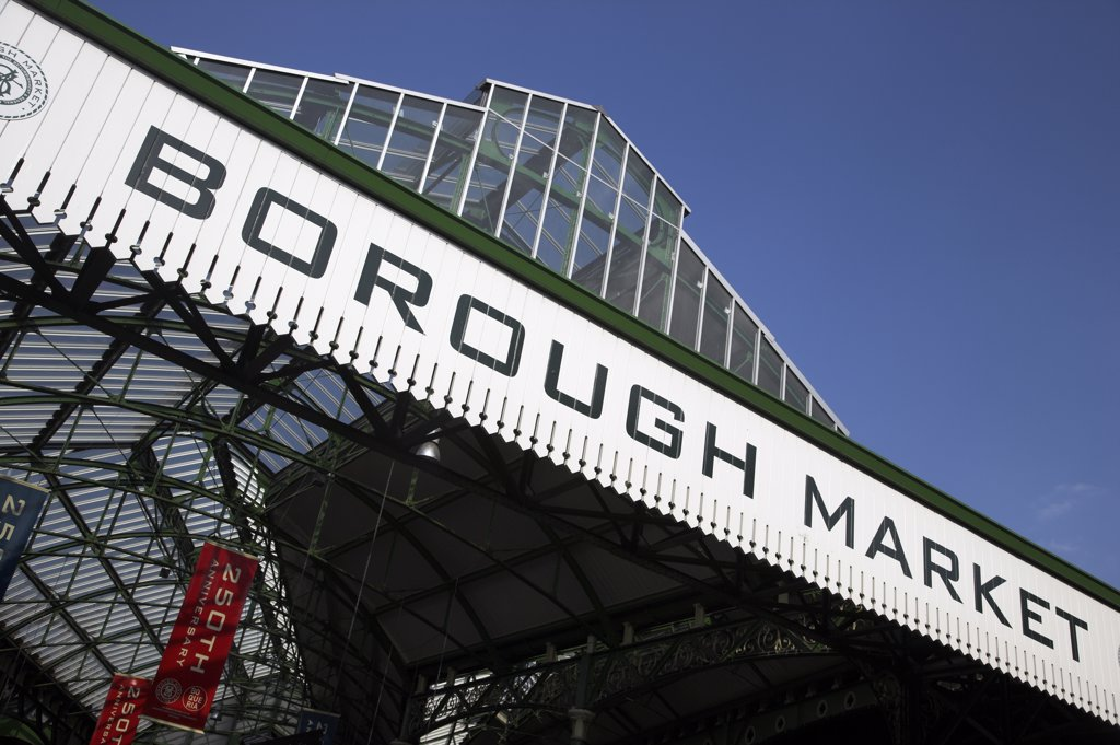 The entrance to Borough Market on Stoney Street. Records of the market go back as far as AD1014, and it has been trading from its present site since 1756 making it the oldest wholesale fruit and vegetable market in London. : Stock Photo