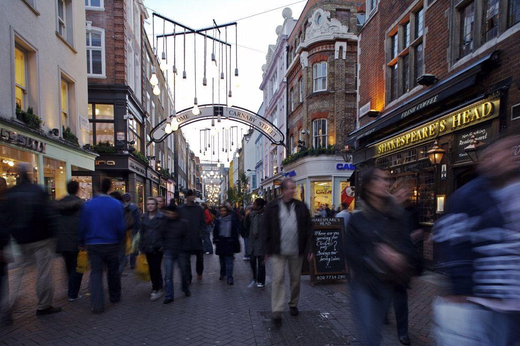 Stock Photo: 4272-8377 Christmas shoppers enjoy the lights in Carnaby Street