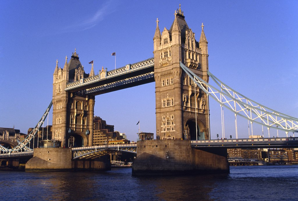 Stock Photo: 4272-8391 The Tower Bridge crossing the River Thames in central London. The bridge designed by Sir Horace Jones and built in 1894, was designed as a drawbridge to allow ships to pass through.