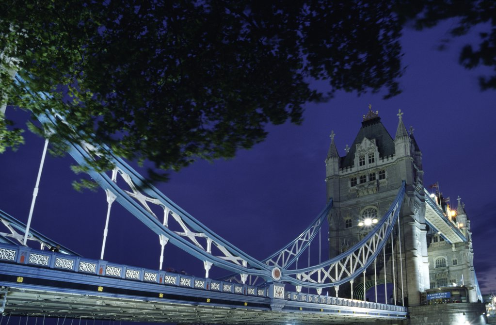 Stock Photo: 4272-8399 The Tower Bridge crossing the River Thames in central London. The bridge designed by Sir Horace Jones and built in 1894, was designed as a drawbridge to allow ships to pass through.