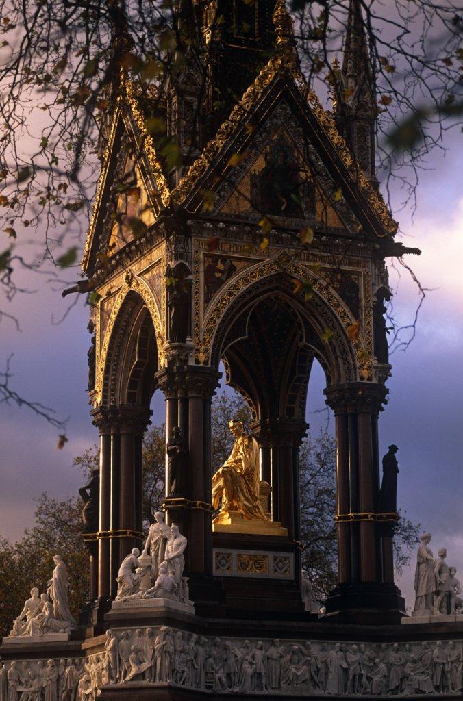 Stock Photo: 4272-8745 England, London. Commissioned by Queen Victoria to commemorate her late consort, Prince Albert. This large statue of Prince Albert in Hyde Park, is seated in a vast Gothic shrine. It includes a frieze with 169 carved figures, angels and virtues higher up and separate groups representing the Continents, Industrial Arts and Sciences.