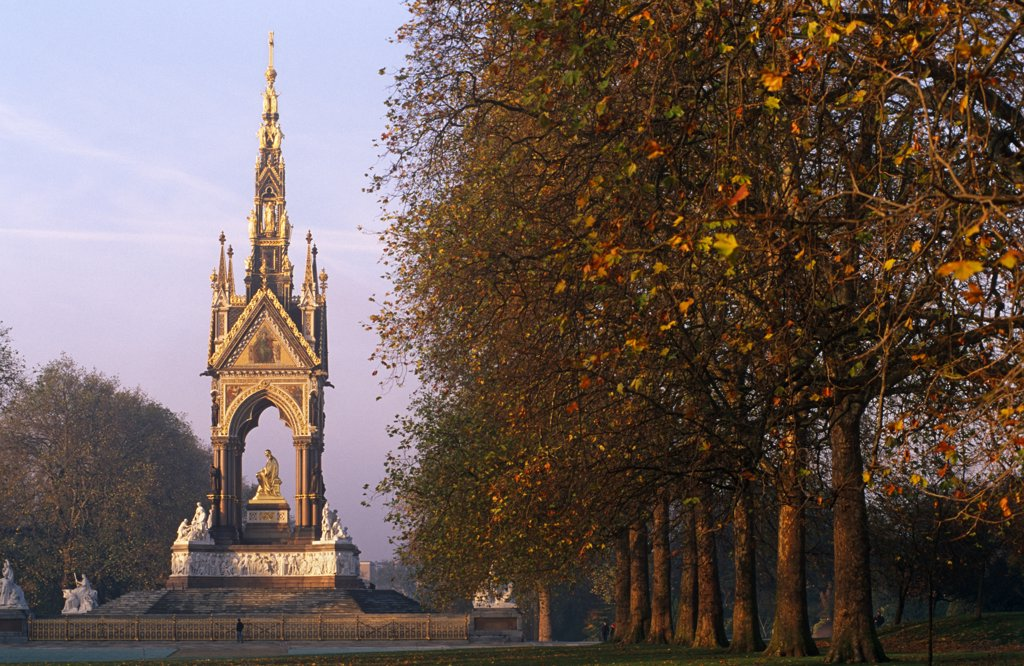 England, London. Commissioned by Queen Victoria to commemorate her late consort, Prince Albert. This large statue of Prince Albert in Hyde Park, is seated in a vast Gothic shrine. It includes a frieze with 169 carved figures, angels and virtues higher up and separate groups representing the Continents, Industrial Arts and Sciences. : Stock Photo