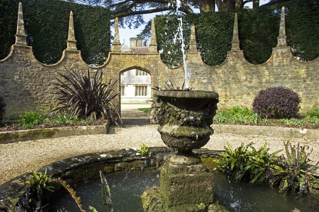Stock Photo: 4272-8977 England, Dorset. Athelhampton is one of the finest examples of 15th century manor houses in England. Medieval in style predominantly and surrounded by walls, water features and secluded courts.