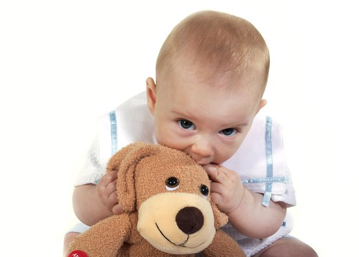 Baby, Boy Playing With A Soft Toy : Stock Photo