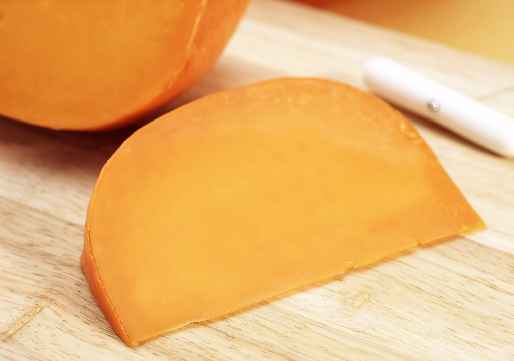 French Cheese called Mimolette, Cheese made from Cow's Milk : Stock Photo