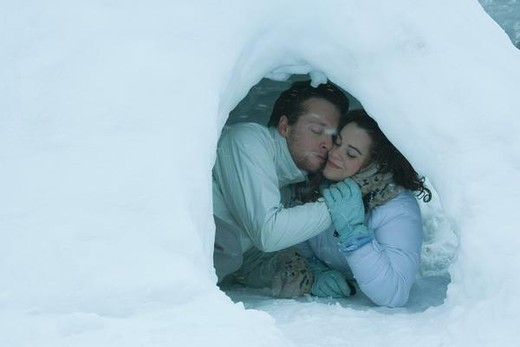 Stock Photo: 4276-1170 Young couple embracing in igloo, eyes closed