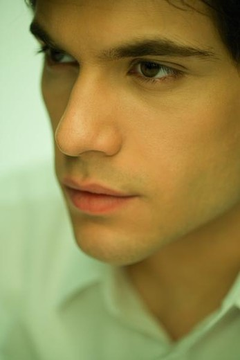 Stock Photo: 4276-1307 Young man looking away, portrait, close-up