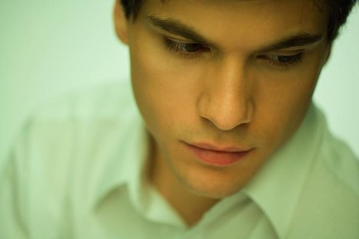 Stock Photo: 4276-1309 Young man looking down, portrait