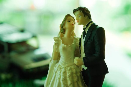 Plastic bride and groom figurines, close-up : Stock Photo