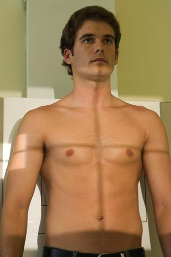Young man undergoing chest x-ray : Stock Photo