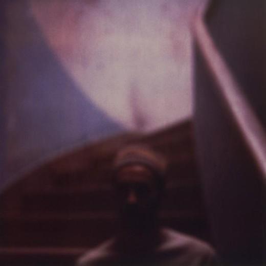Stock Photo: 4276-1617 Man in dark stair-well