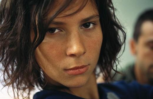 Stock Photo: 4276-1709 Young woman looking at camera, headshot