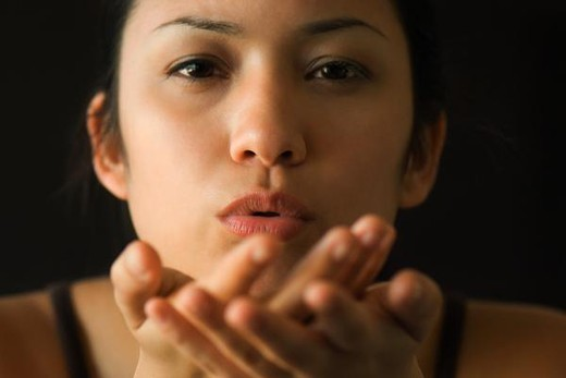 Stock Photo: 4276-3130 Woman blowing kiss, close-up