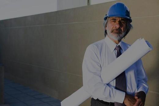 Architect carrying blueprint under arm, portrait : Stock Photo