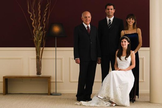 Three generation family dressed in formal attire, full length portrait : Stock Photo