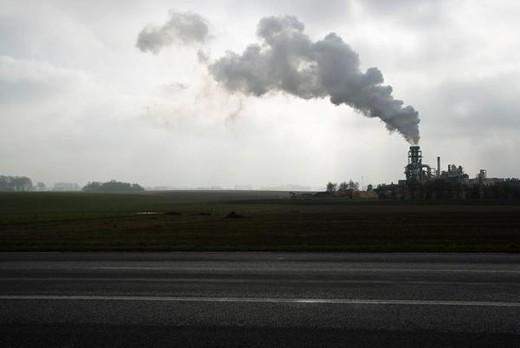 Smoke plume above factory : Stock Photo