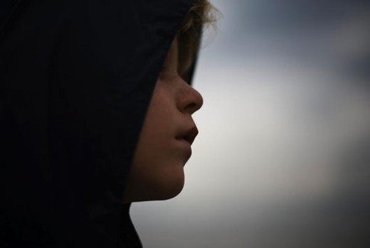 Stock Photo: 4276-3784 Boy looking away contemplatively