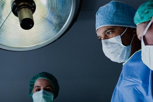 Stock Photo: 4276-4478 Surgical team at work operating room