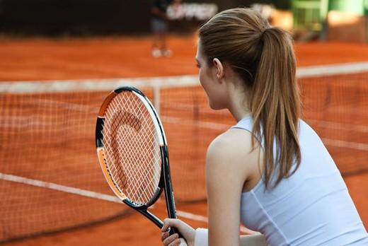 Teenage girl playing tennis : Stock Photo