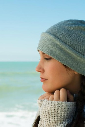 Stock Photo: 4276-4611 Teen girl at the beach, profile, portrait