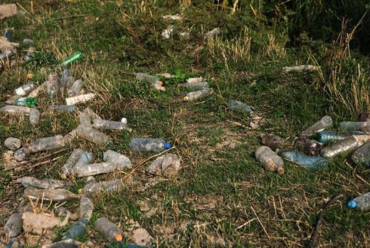 Stock Photo: 4276-5082 Discarded plastic bottles littering the ground