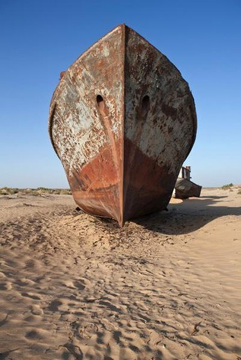 Stock Photo: 4276-5108 Uzbekistan, Moynaq, rusty boats beached in the desert which used to be the Aral Sea