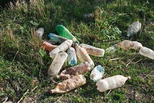 Stock Photo: 4276-5228 Discarded plastic bottles littering the ground