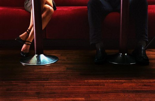 Stock Photo: 4276-6748 Woman's and man's legs in bar, view from under table