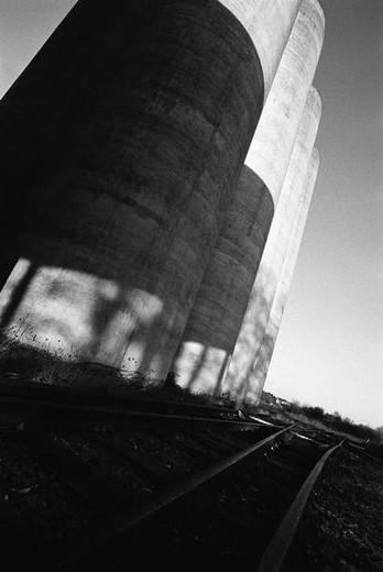 Railtracks and Silos, b&w : Stock Photo