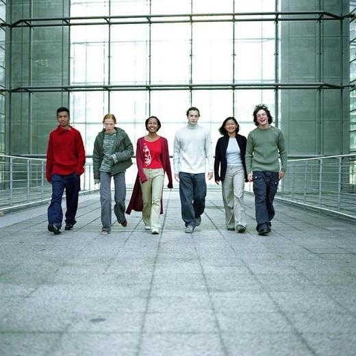 Stock Photo: 4276-6989 Urban scene, young people walking