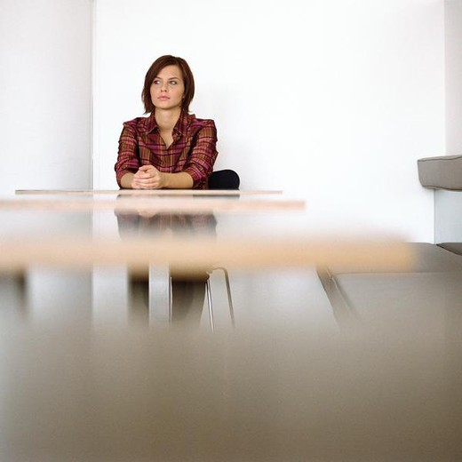 Stock Photo: 4276-7073 Woman sitting at end of table