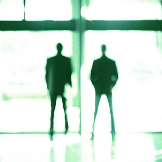 Two men in front of glass window, silhouette : Stock Photo