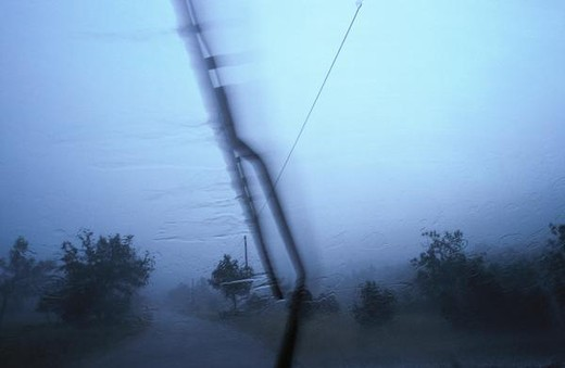 Windshield wiper and rainy landscape : Stock Photo