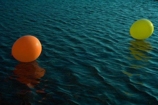 Stock Photo: 4276-9199 Two balloons floating on water
