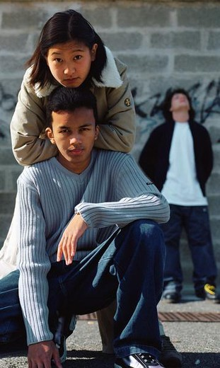 Stock Photo: 4276-9450 Urban scene, young people in front of wall with graffiti