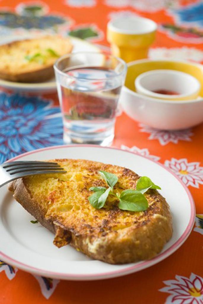 Savory french toast seasoned with fresh basil : Stock Photo