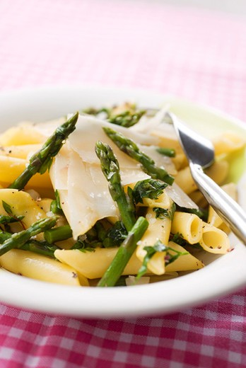 Penne with asparagus and saffron : Stock Photo