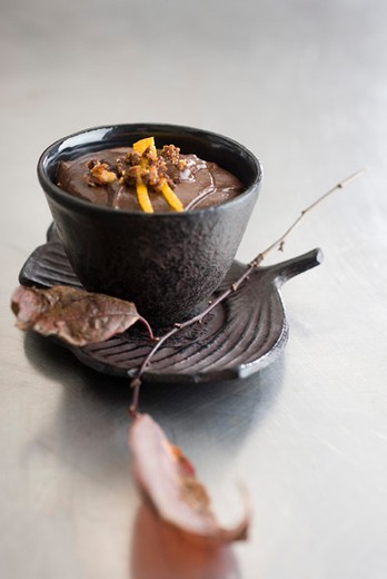 Chocolate mousse topped with caramelized hazelnuts and orange zest : Stock Photo