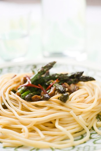Spaghetti with asparagus, ginger and soy sauce : Stock Photo