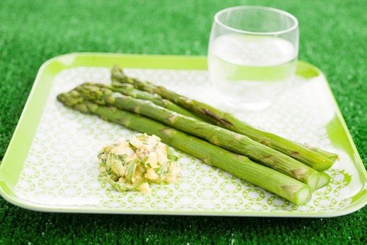 Grilled asparagus with sauce gribiche : Stock Photo