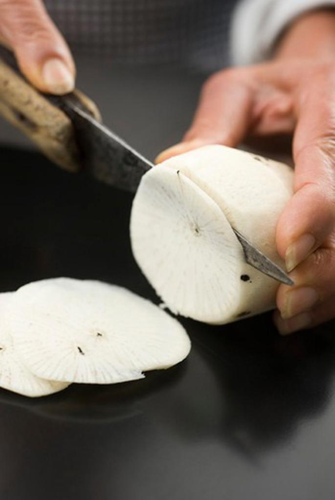 Stock Photo: 4277-2347 Slicing radish